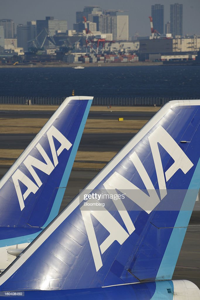 The All Nippon Airways Co. (ANA) logo is displayed on the tails of aircraft parked at Haneda Airport in Tokyo, Japan, on Wednesday, Jan. 30, 2013. ANA has canceled a total of 784 flights, affecting 74,200 passengers through Feb. 12, since a Jan. 16 incident that led to the global grounding of Boeing Co. 787s, according to figures from the company. Photographer: Akio Kon/Bloomberg via Getty Images