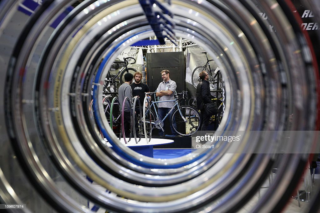 The All-City bike stand seen through a display of wheel rims at the London Bike Show which is being held in the ExCeL Centre on January 17, 2013 in London, England. The ExCeL centre is hosting The Outdoors Show, the London Bike Show and the Active Travel Show which run until January 20, 2013 and features manufacturer trade stalls, speeches, demonstrations and areas where visitors can climb or ride bikes.