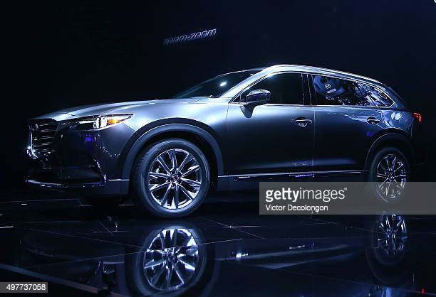 The allnew CX9 is revealed by Mazda during the LA Auto Show on November 18 2015 in Los Angeles California A threerow midsized crossover SUV featuring...