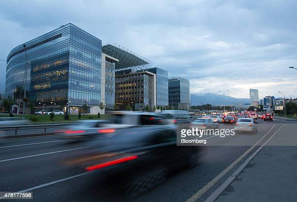 The Almaty financial center left stands beyond a busy traffic highway in Almaty Kazakhstan on Monday June 22 2015 Kazakhstan completed its...