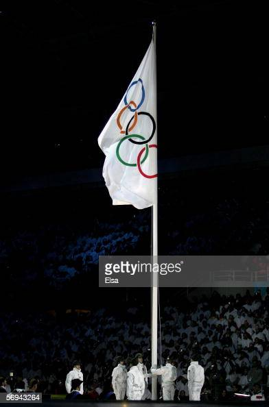 The Alpini guard lower the Olympic flag during the Closing Ceremony of the Turin 2006 Winter Olympic Games on February 26 2006 at the Olympic Stadium...