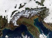 'Heralding the oncoming winter, snow dusts the peaks of the Alps in this true-color Terra MODIS image from December 11, 2004. North of the Alps, clouds cover France, Switzerland, Liechtenstein, Austri