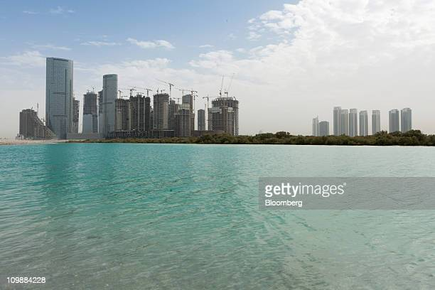 The AlReem island construction project stands behind mangrove swamps in Abu Dhabi United Arab Emirates on Tuesday March 8 2011 Royal Group which...