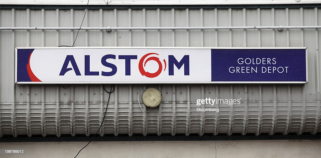 The Alstom SA company logo sits on a wall outside the company's London Underground Traincare Centre in the Golders Green district of London UK on...