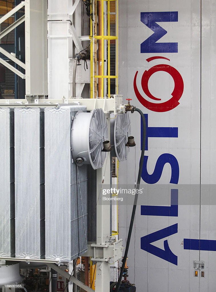 The Alstom SA logo is seen in the industrial power transformer testing area at the company's factory in Stafford, U.K., on Tuesday, Jan. 15, 2013. Alstom surged 29 percent in Paris trading in 2012, beating the 15 percent gain of the the French benchmark CAC 40 Index. Photographer: Chris Ratcliffe/Bloomberg via Getty Images