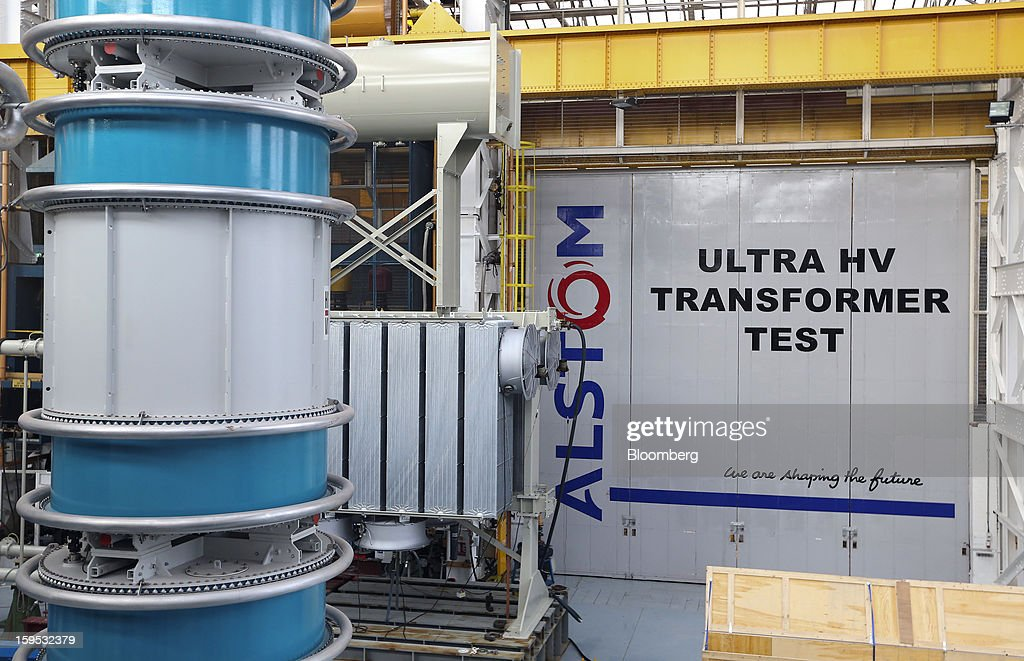 The Alstom SA logo is seen in the testing area for industrial power transformers at the company's factory in Stafford, U.K., on Tuesday, Jan. 15, 2013. Alstom surged 29 percent in Paris trading in 2012, beating the 15 percent gain of the the French benchmark CAC 40 Index. Photographer: Chris Ratcliffe/Bloomberg via Getty Images