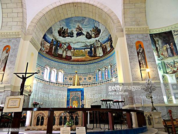 CONTENT] The altar in the cathedral of Notre Dame d'Afrique in Algiers/Algeria with the statue of the Virgin Mary in black stone