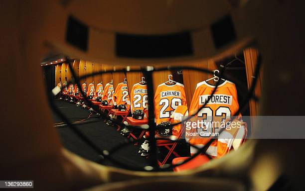 The alumni jerseys and equipment hang in the Philadelphia Flyers alumni locker room before the start of the Alumni game prior to the 2012 NHL...