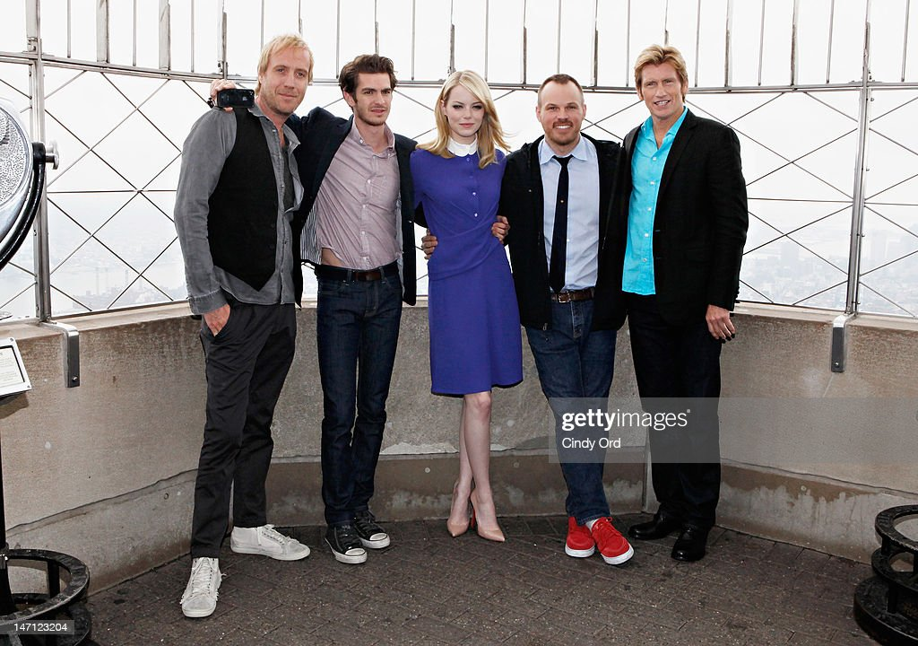 'The Amazing Spider-Man' Cast (L - R) actor Rhys Ifans, actor Andrew Garfield, actor Emma Stone, director Marc Webb, and actor Denis Leary visit The Empire State Building on June 25, 2012 in New York City.