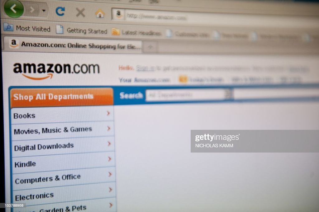 The Amazon homepage appears on a screen in Washington on September 3 2010 AFP PHOTO/Nicholas KAMM