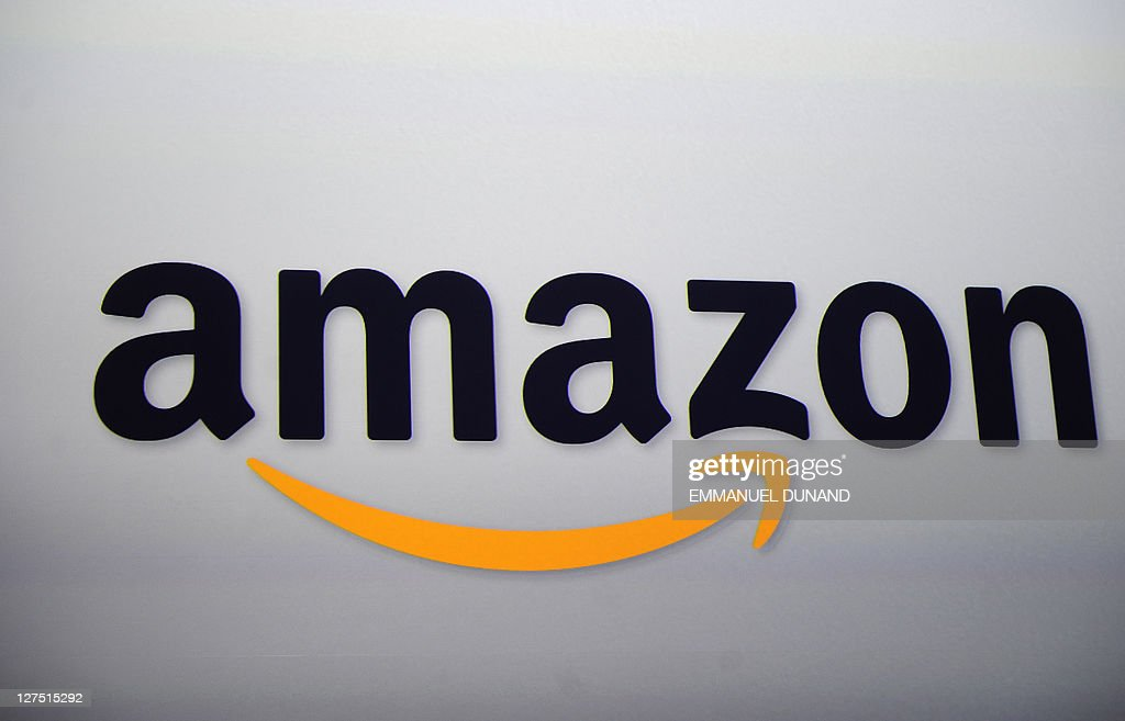 The Amazon logo is projected on a screen at a press conference in New York on September 28, 2011. Amazon CEO Jeff Bezos introduced a line of four new Kindle products, the Kindle Fire tablet, the Kindle Touch 3G, the Kindle Touch and a new lighter and smaller Kindle. AFP PHOTO/Emmanuel Dunand