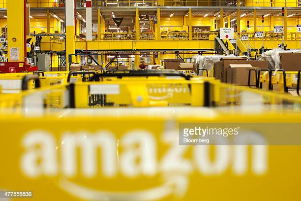 The Amazon logo sits on a cart parked in the inbound goods zone at the Amazoncom Inc fulfillment center in Poznan Poland on Friday June 12 2015...