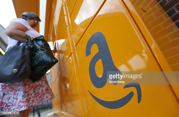 The Amazon logo sits on an Amazoncom Inc pickup and collect locker as a customer collects an online purchase at Newbury Park railway station in...