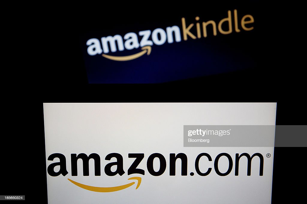 The Amazon.com Inc. and Amazon Kindle logos are displayed on laptop computers in Washington, D.C., U.S., on Wednesday, Oct. 23, 2013. Amazon.com Inc. is scheduled to release third-quarter earnings on Oct. 24. Photographer: Andrew Harrer/Bloomberg via Getty Images