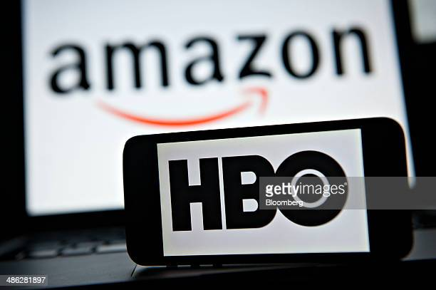 The Amazoncom Inc and HBO network logos are displayed for a photograph in Tiskilwa Illinois US on Wednesday April 23 2014 Amazoncom Inc said today...