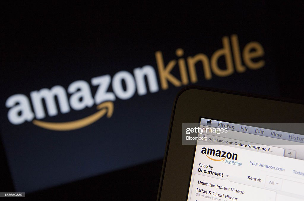 The Amazon.com Inc. homepage and Amazon Kindle logo are displayed on laptop computers in Washington, D.C., U.S., on Wednesday, Oct. 23, 2013. Amazon.com Inc. is scheduled to release third-quarter earnings on Oct. 24. Photographer: Andrew Harrer/Bloomberg via Getty Images