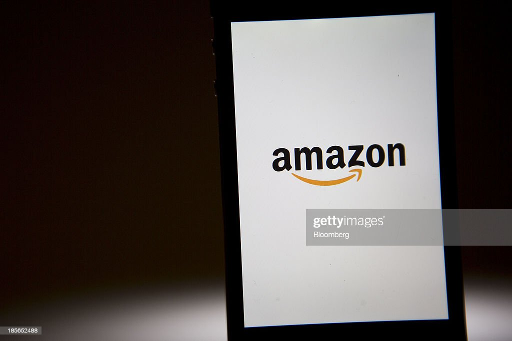 The Amazon.com Inc. logo is displayed on an Apple Inc. iPhone in Washington, D.C., U.S., on Wednesday, Oct. 23, 2013. Amazon.com Inc. is scheduled to release third-quarter earnings on Oct. 24. Photographer: Andrew Harrer/Bloomberg via Getty Images