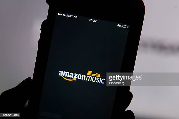 The Amazoncom Inc Prime Music logo is displayed on an Apple Inc iPhone 5 for a photograph in San Francisco California US on Thursday June 12 2014...