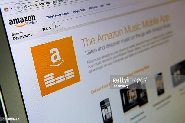 The Amazoncom Inc Prime Music logo is displayed on an Apple Inc laptop for a photograph in San Francisco California US on Thursday June 12 2014...