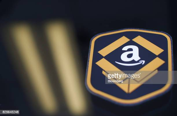 The Amazoncom logo is seen during the company's job fair in Kenosha Wisconsin US on Wednesday Aug 2 2017 The US Department of Labor is scheduled to...