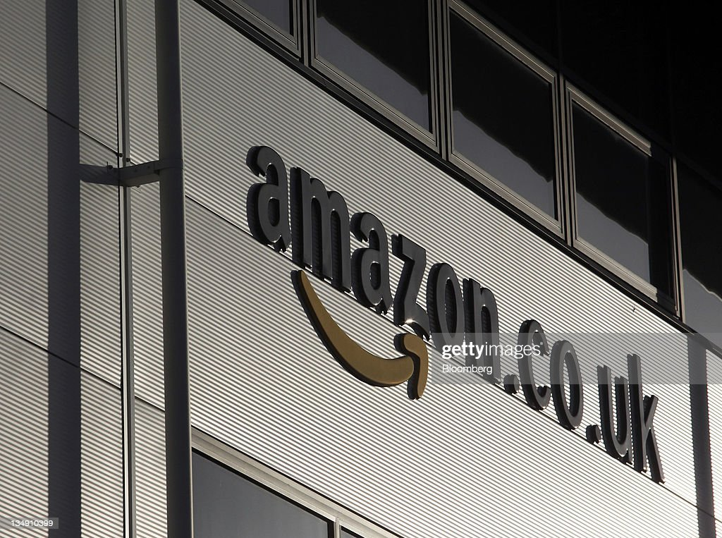 The Amazon.co.uk.logo is seen on the Marston Gate 'Fulfillment Center,' the U.K. site of Amazon.com Inc., in Ridgmont, U.K., on Monday, Dec. 5, 2011. The Amazon. Com Inc's Marston Gate 'Fulfillment Center' is seen in Ridgmont, U.K., on Monday, Dec. 5, 2011. Amazon.com Inc.'s share of the tablet computer market will surge to 14 percent this quarter as consumer demand catapults the Kindle Fire to the No. 2 spot after Apple Inc.'s iPad, according to research firm IHS Inc. Photographer: Chris Ratcliffe/Bloomberg via Getty Images