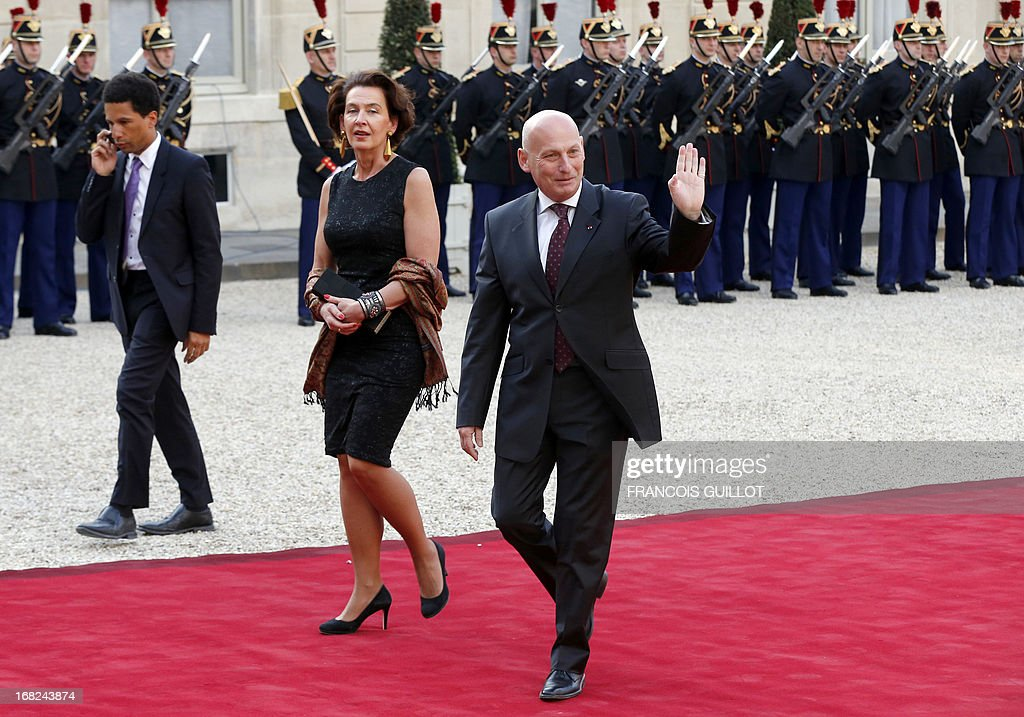 The ambassador of Poland in France Tomasz Orlowski waves as he arrives with his wife Aleksandra Orlowska at the Elysee presidential palace on May, 7, 2013, in Paris, to attend a State dinner with French President and Polish President as part of the two-day state visit of Poland's President. AFP PHOTO / FRANCOIS GUILLOT