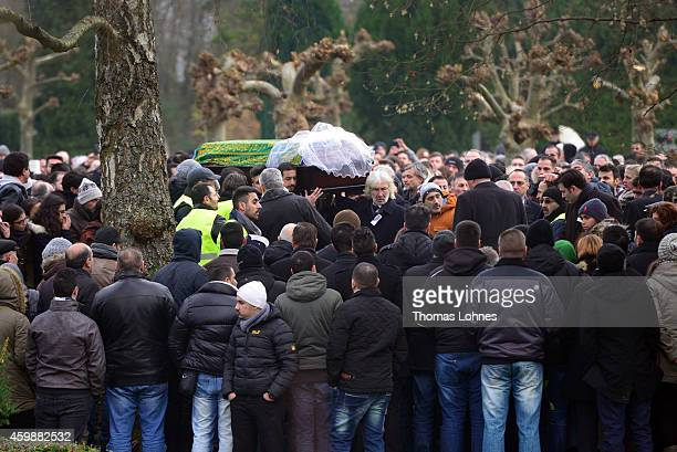 The Ambassador of Turkey Hueseyin Avni Karslioglu goes before the coffin with Tugce Albayrak the 23yearold university student who died after she was...