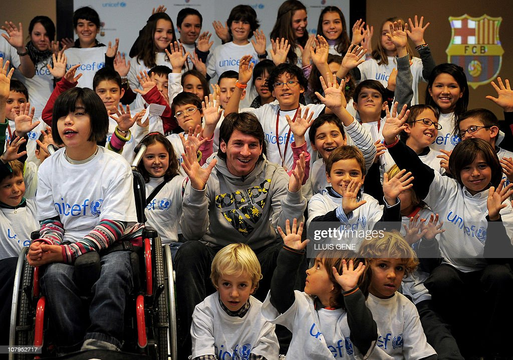 The ambassador of Unicef and Barcelona's Argentinian forward Lionel Messi takes part in a sesseion of children on December 9 2010 at the Camp Nou...