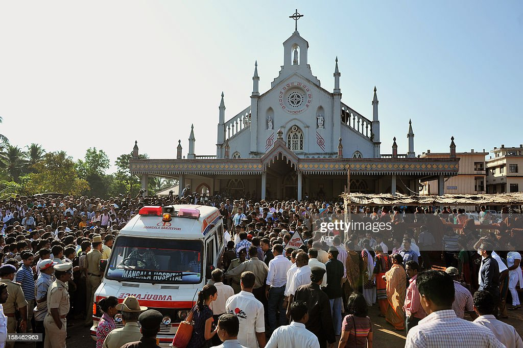 The ambulance transporting the coffin of late nurse Jacintha Saldanha arrives at the Shirve Church for a funeral near Mangalore on December 17, 2012. About 2,000 mourners have packed a Catholic church in southwest India for the funeral of the nurse who was found hanged after taking a hoax call to the hospital treating Prince William's wife. Indian-born Jacintha Saldanha, 46, apparently committed suicide after answering the telephone call from Australian radio DJs to the hospital where the pregnant Duchess of Cambridge was admitted with acute morning sickness. AFP PHOTO/Manjunath KIRAN