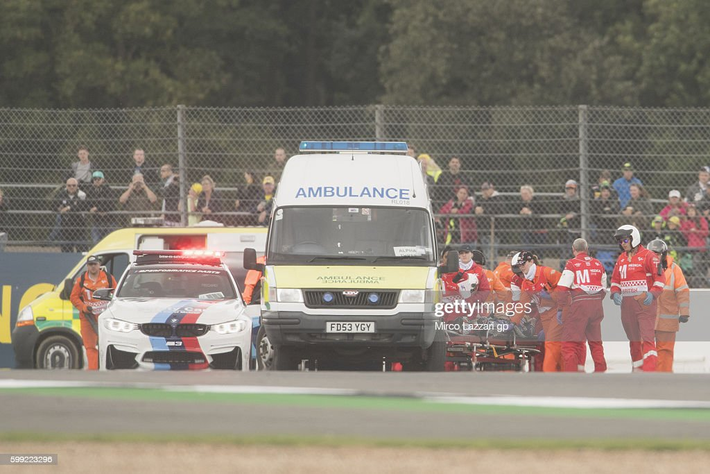 The ambulance with Loris Baz of France and Avintia Racing after crashed out during the MotoGP race during the MotoGp Of Great Britain - Race at Silverstone Circuit on September 4, 2016 in Northampton, England.