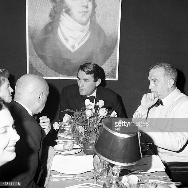 The American actor Gregory Peck during a dinner in the Cannes film festival