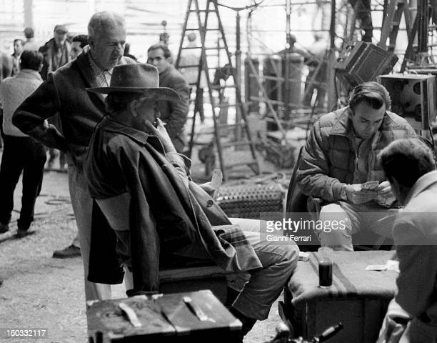 The American actor John Wayne during a break from filming 'Circus World' directed by Henry Hataway Madrid Spain