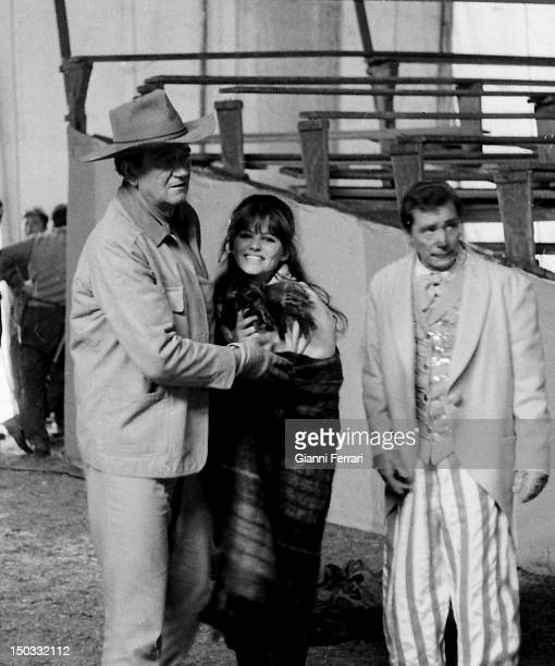 The American actor John Wayne with Italian actress Claudia Cardinale during a break from filming 'Circus World' directed by Henry Hataway Madrid Spain