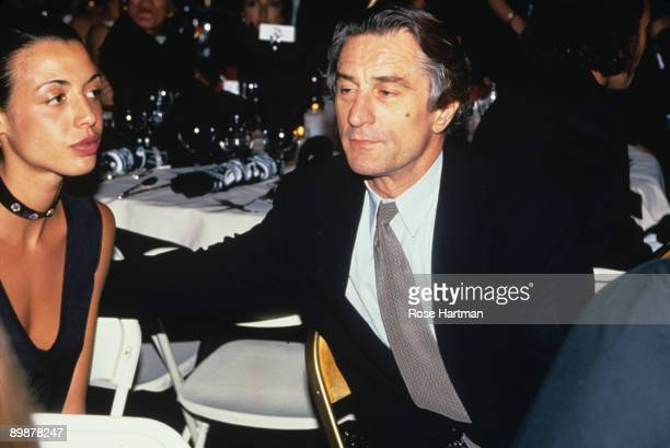 The American actor Robert De Niro sits with daughter Drena at a dinner hosted by the designer Giorgio Armani New York 1990s