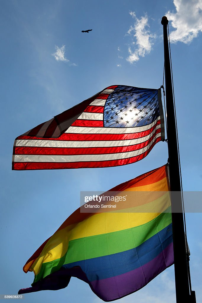 The American and gay pride flags fly at halfmast over the GLBT Community Center of Central Florida Monday June 13 2016 in Orlando The Center is...
