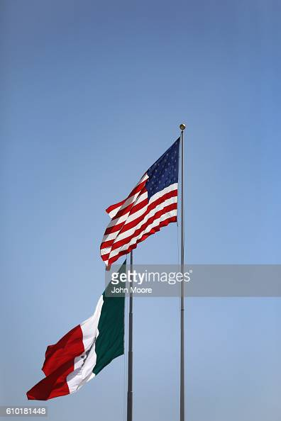The American and Mexican flags stand on either side of the USMexico border on September 23 2016 in Tijuana Mexico Securing the border and controlling...