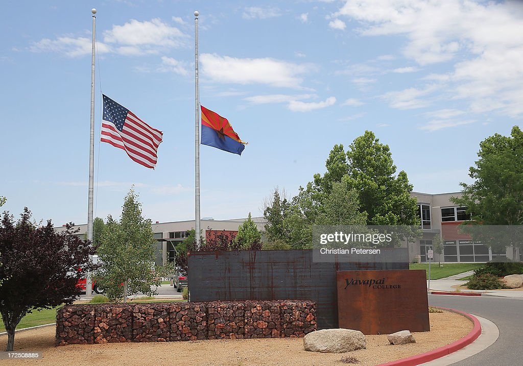 The American and State of Arizona flags fly at half mast outside of Yavapai College for victims of the Yarnell Hill wildfires on July 2, 2013 in Prescott, Arizona. The Red Cross is providing families displaced by the fires in Yarnell, AZ food and shelter. Nineteen Granite Mountain Interagency Hotshot Crew firefighters died battling the fast-moving wildfire that has burned nearly 8,400 acres.