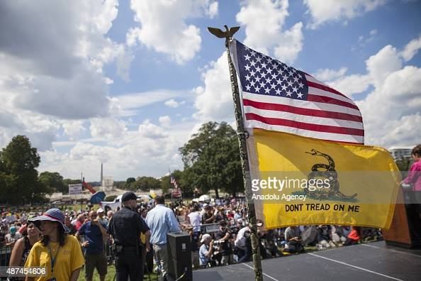 The American and Tea Party flags fly on the side of the stage at a rally held by the Tea Party at the United States Capitol to speak out against...