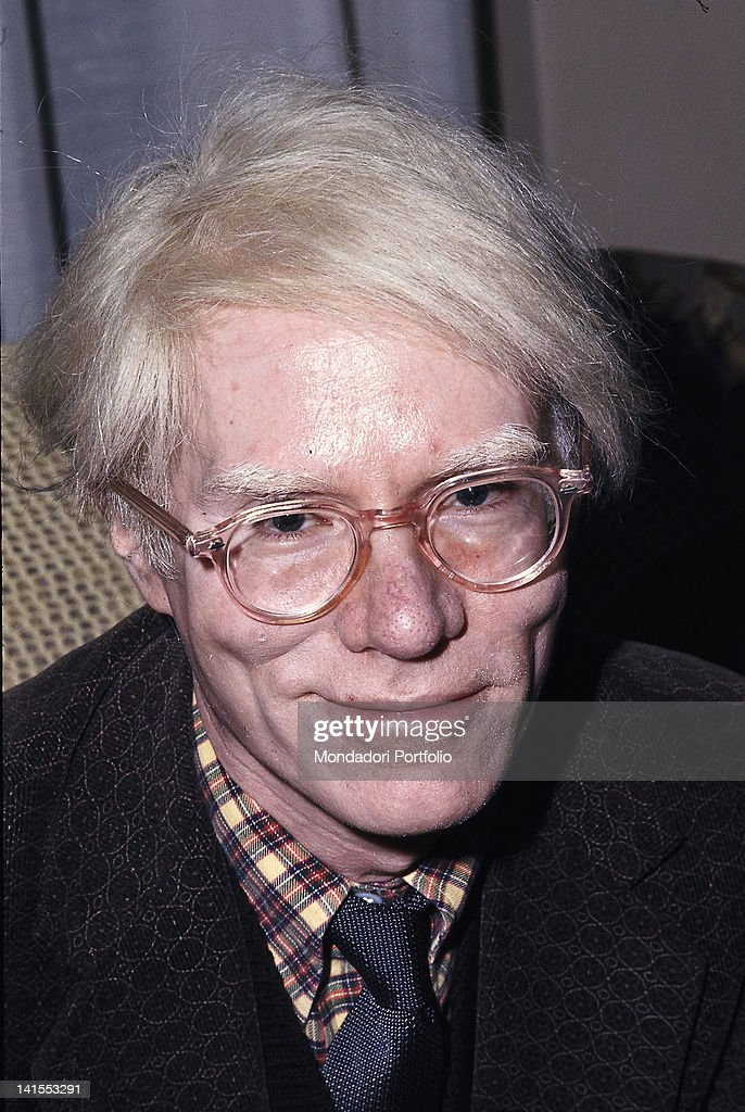 The American artist <a gi-track='captionPersonalityLinkClicked' href=/galleries/search?phrase=Andy+Warhol&family=editorial&specificpeople=123830 ng-click='$event.stopPropagation()'>Andy Warhol</a> smiling at his exhibition dedicated to Black transvestites in the US. Ferrara, November 1975