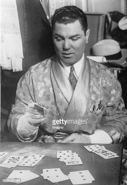 The American boxer Jack Dempsey plays cards 1930 Photograph