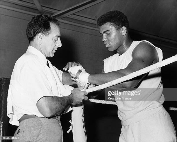 The American boxer Muhammad ALI having his hand banded by his trainer Angelo DUNDEE in White City The heavyweight champion was training in Army...