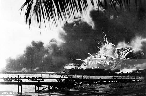 The American destroyer USS Shaw explodes during the Japanese attack on Pearl Harbour home of the American Pacific Fleet during World War II