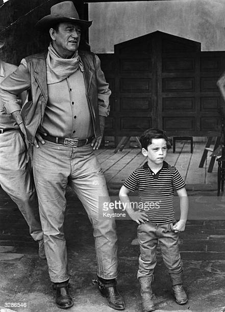 The American film star John Wayne with his son on location in Mexico for the filming of 'War Wagon'
