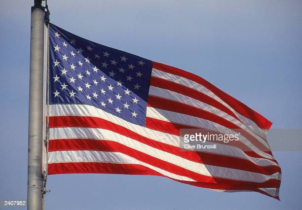 The American Flag flies above the USTA National Tennis Center during the US Open in Flushing Meadows Corona Park on August 25 1997 in Flushing New...
