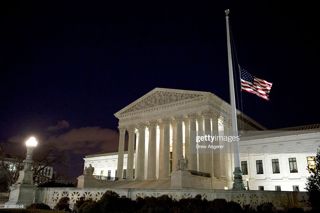 The American flag flies at half mast at the U.S. Supreme Court February 13, 2016 in Washington, DC. Supreme Court Justice Antonin Scalia was at a Texas Ranch Saturday morning when he died at the age of 79.