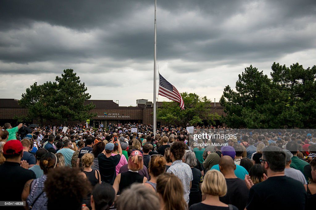 The American flag flies at half mast outside of J J Hill Montessori School where Philando Castile worked during a demonstration for Philando Castile...