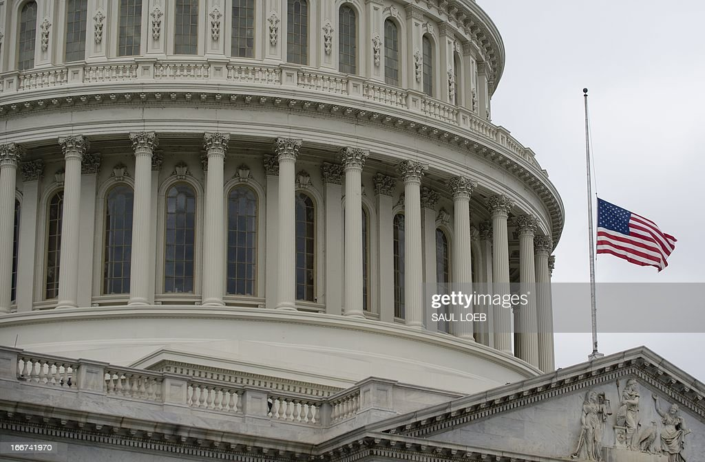 The American flag flies at half staff over the US Capitol in Washington on April 16, 2013 in honor of the the three people killed in the bombings at the Boston Marathon. AFP PHOTO / Saul LOEB
