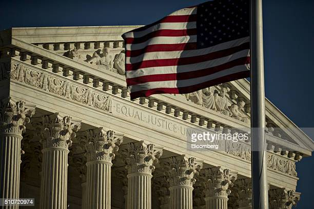 The American flag flies at halfstaff in front of the US Supreme Court building in Washington DC US on Tuesday Feb 16 2016 Justice Antonin Scalia's...