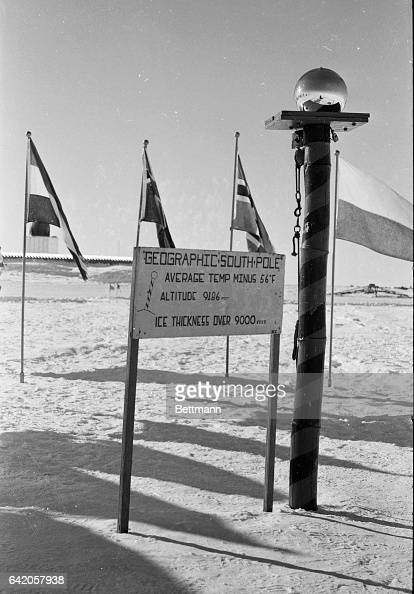 The American flag flies here over an aluminum dome at the U S scientific station in Antarctica the only continent never bloodied by the wars of man...