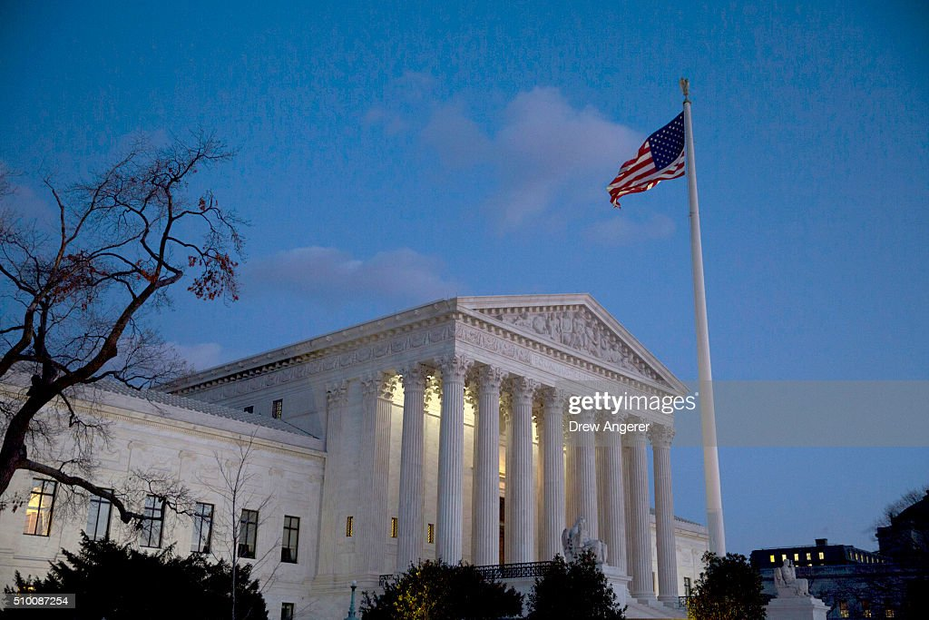 The American flag flies in front of the U.S. Supreme Court February 13, 2016 in Washington, DC. Supreme Court Justice Antonin Scalia was at a Texas Ranch Saturday morning when he died at the age of 79.
